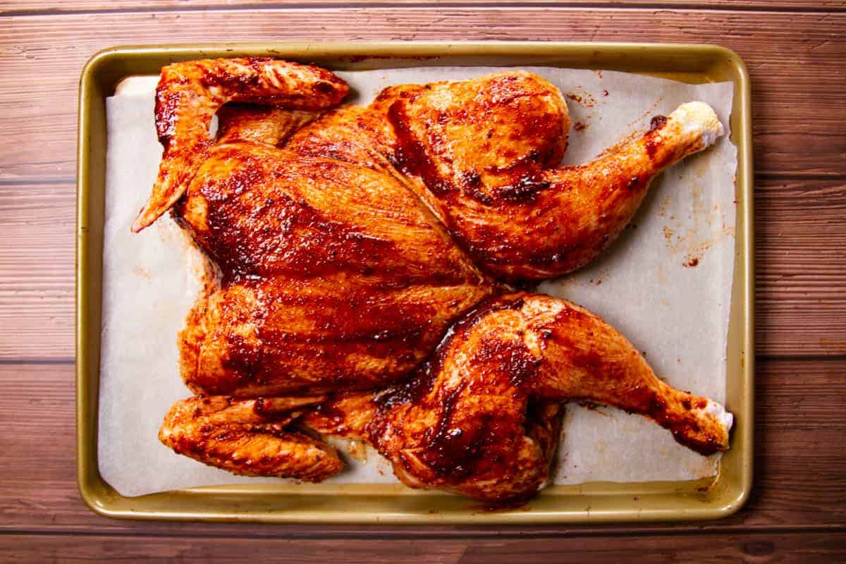The chicken, rubbed in the marinade.