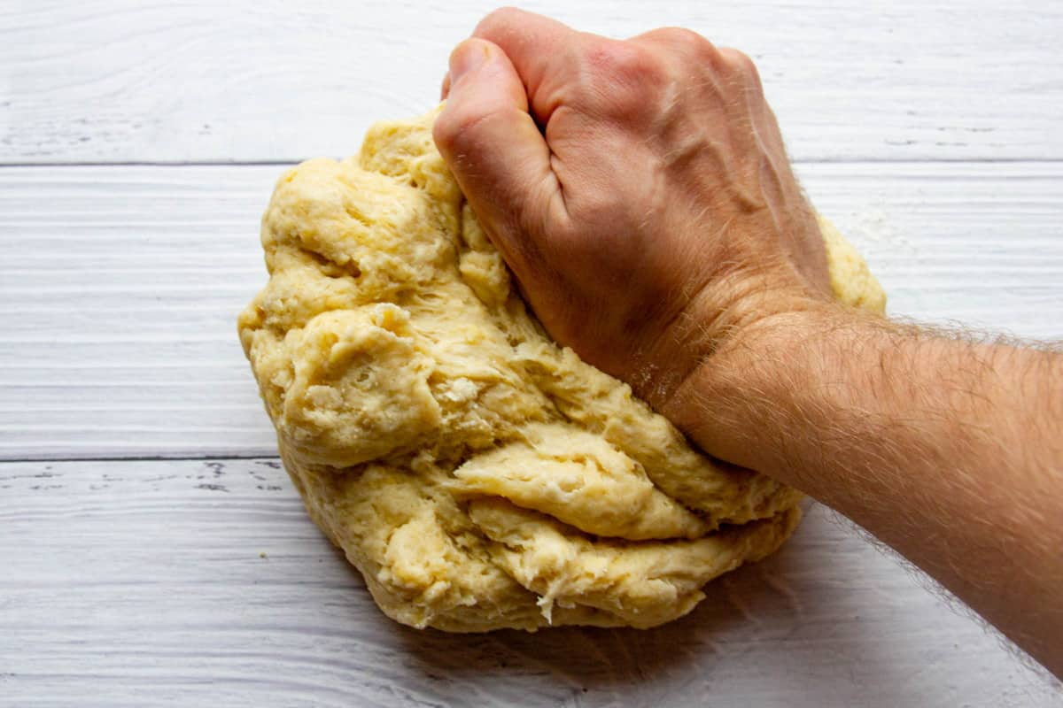 Kneading the dough on a board.