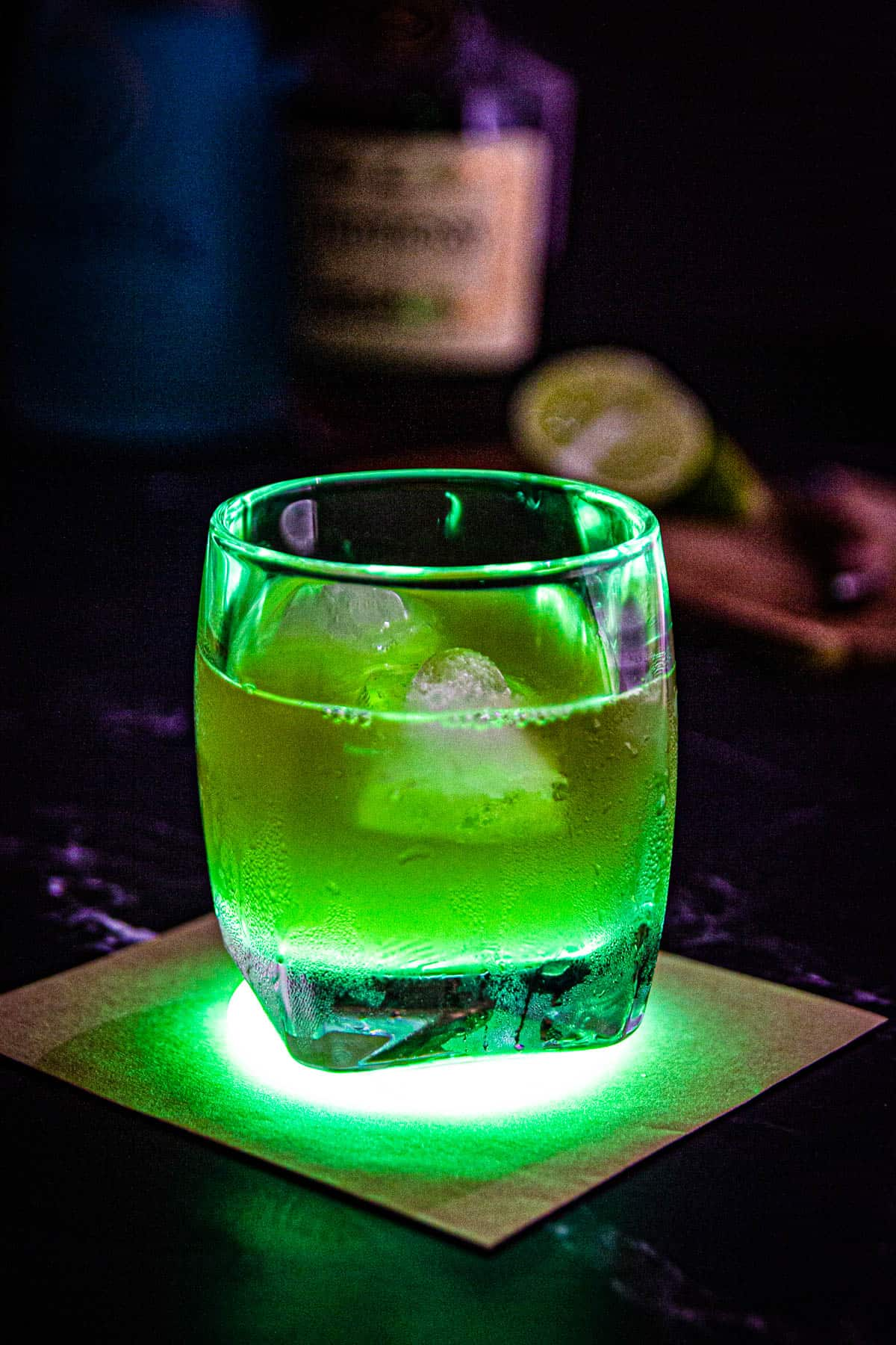 A glowing green incredible hulk drink cocktail.