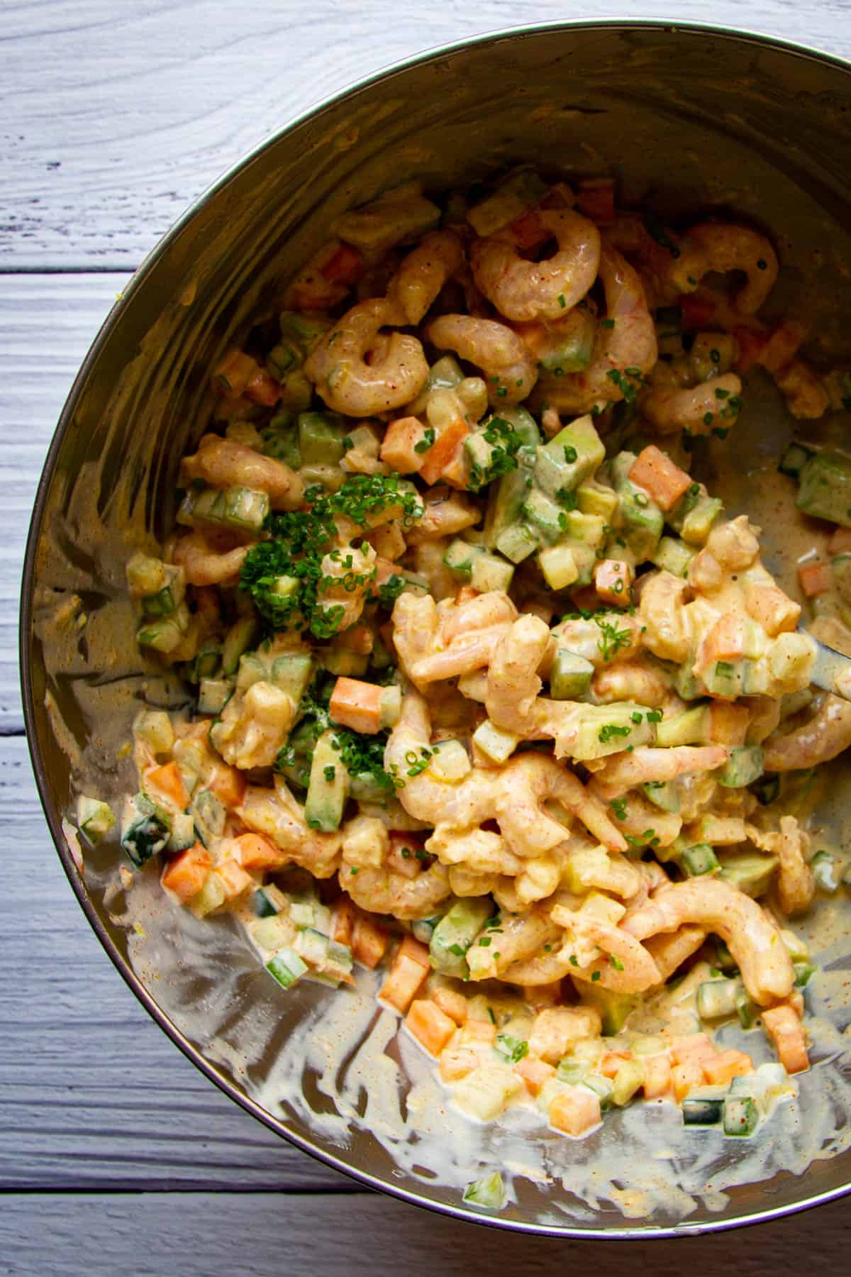 All of the ingredients for the shrimp salad mixed together.