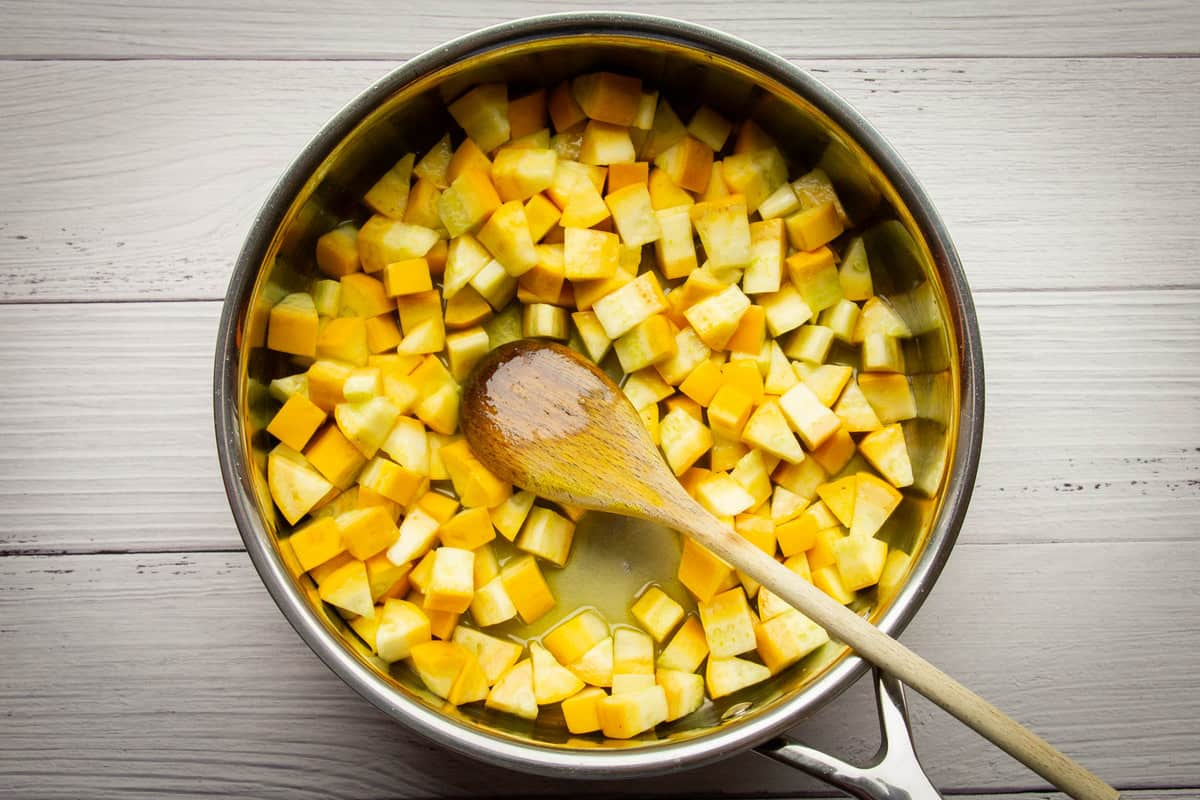 Cooking the yellow zucchini in the garlic oil.