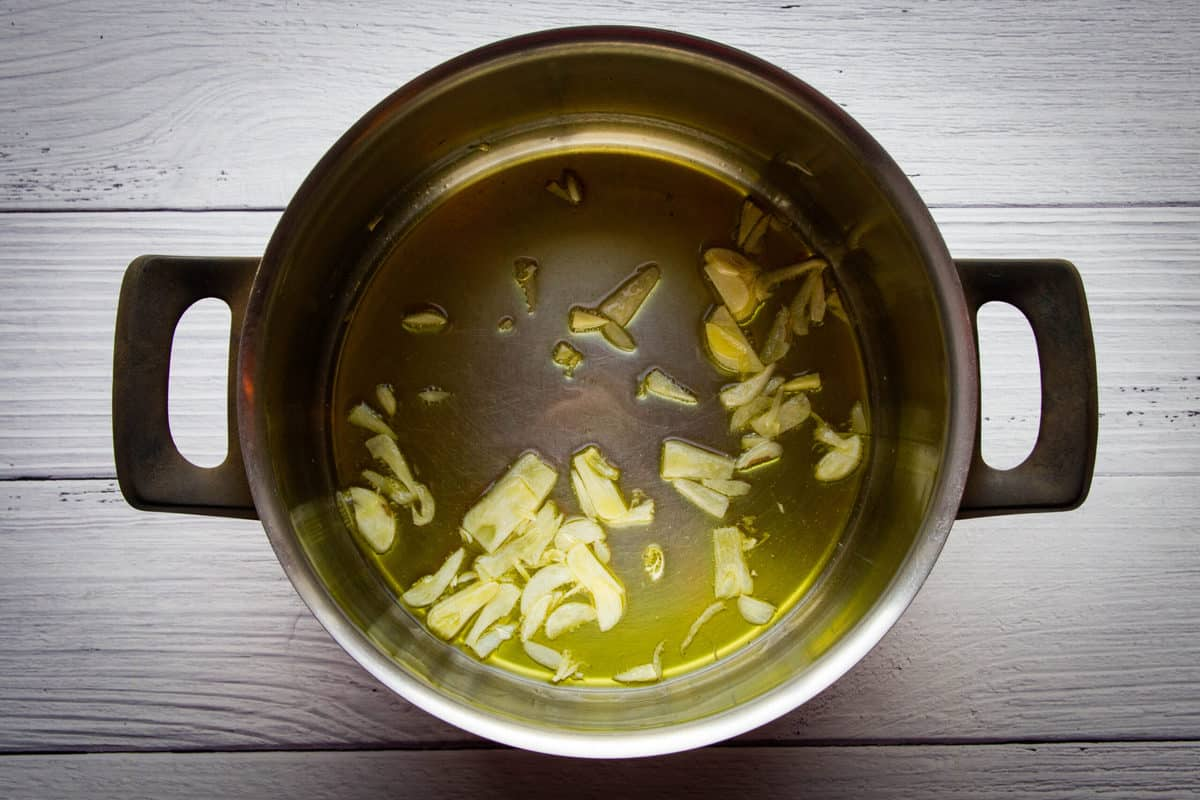 Cooking the garlic in the olive oil until fragrant.