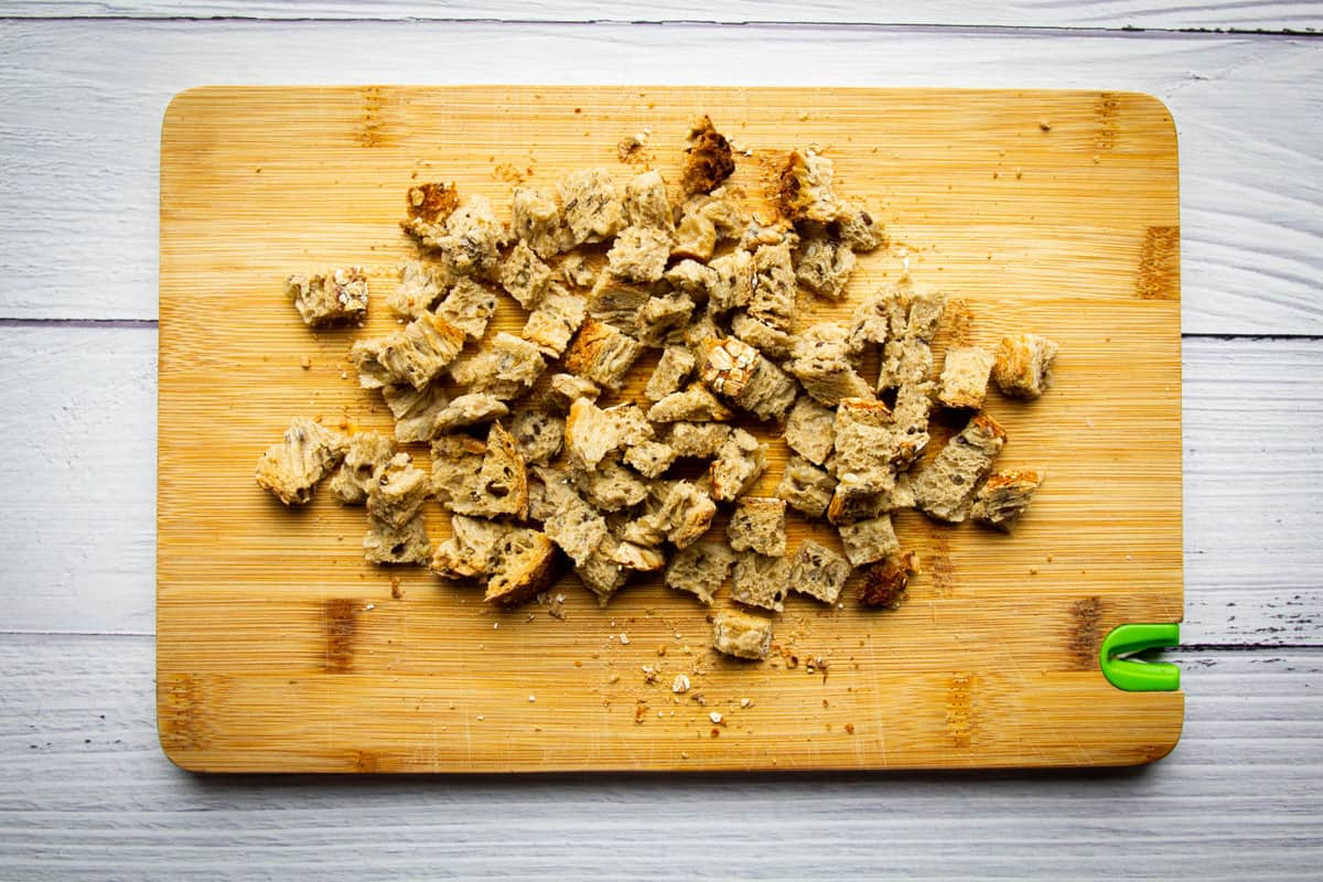 Cutting the croutons into little squares.