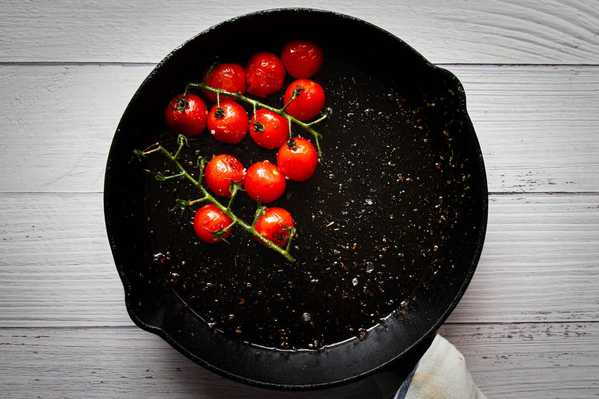Frying the cherry tomatoes in the pan.