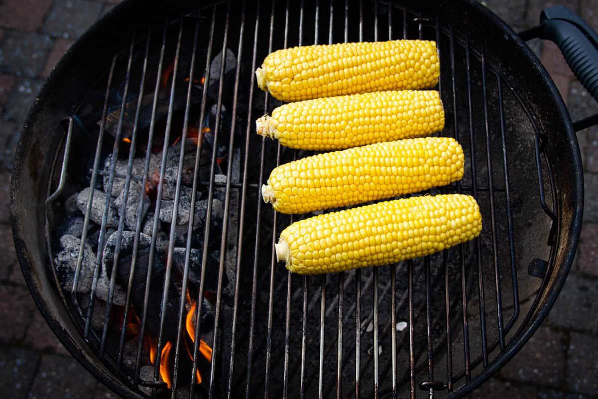 Smoking the corn on indirect heat.