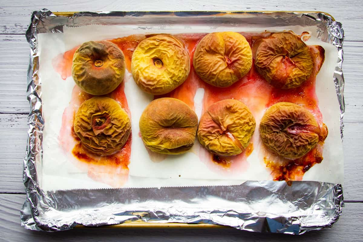 The roasted peaches on a tray.