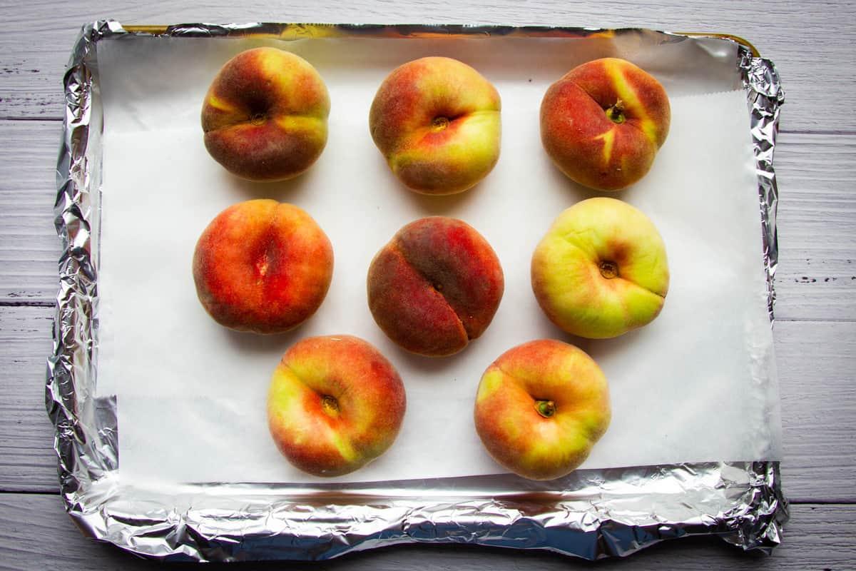 White peaches on a tray.