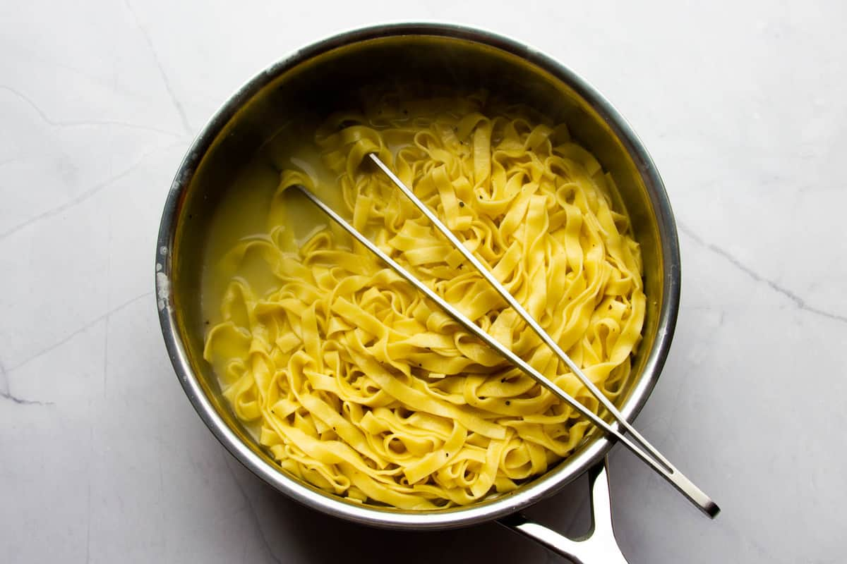Cooking the pasta in lot of starchy pasta water.