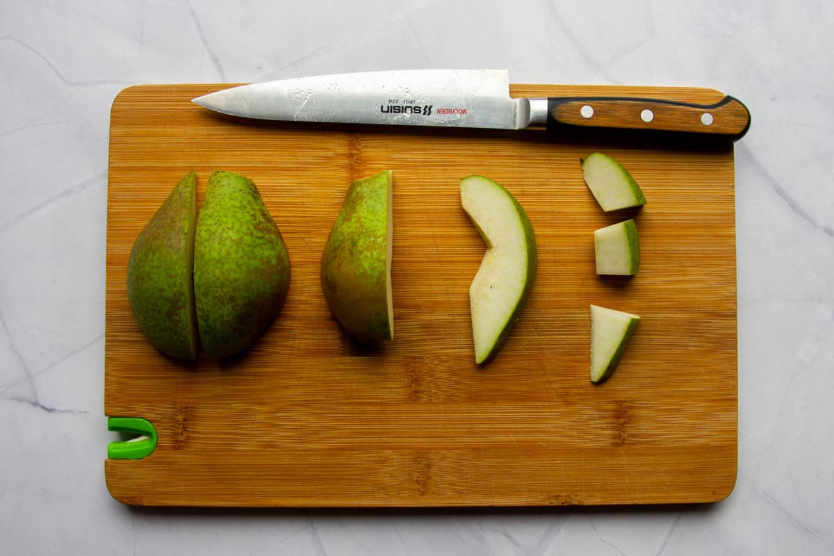Slicing the pear into small pieces.